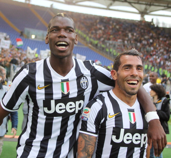 ROME, ITALY - MAY 11: Paul Labile Pogba with Carlos Tevez of Juventus celebrate the victory after the Serie A match between AS Roma and Juventus at Stadio Olimpico on May 11, 2014 in Rome, Italy.  (Photo by Paolo Bruno/Getty Images)