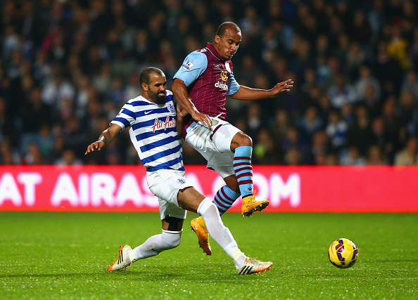 LONDON, ENGLAND - OCTOBER 27: Sandro of QPR tackles Gabriel Agbonlahor of Aston Villa  during the Barclays Premier League match between Queens Park Rangers and Aston Villa at Loftus Road on October 27, 2014 in London, England.  (Photo by Ian Walton/Getty Images)