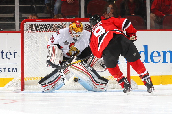 NEWARK, NJ - DECEMBER 08:  Zach Parise #9 of the New Jersey Devils scores a shootout goal against Alex Auld #35 of the Ottawa Senators during their game on December 8, 2011 at The Prudential Center in Newark, New Jersey  (Photo by Al Bello/Getty Images)