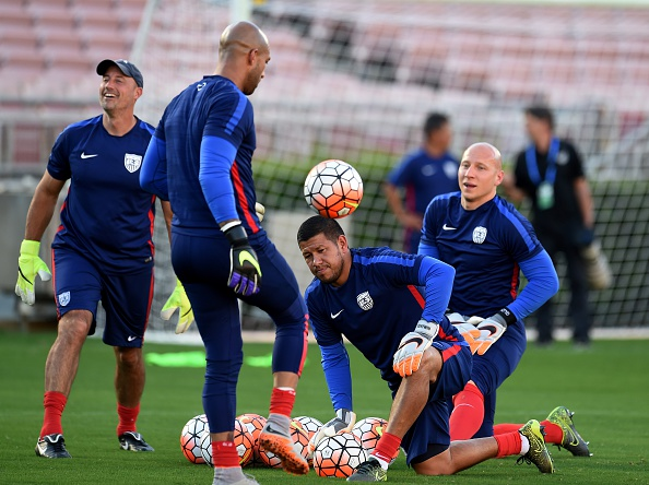 US Men's soccer team goalkeepers Tim Howard (2L) and Brad Guzan (R) work with coaching staff during a training session at the Rose Bowl in Pasadena, California on October 9, 2015.  Mexico plays the United States here in the playoff match for the FIFA Confederations Cup.      AFP PHOTO / MARK RALSTON        (Photo credit should read MARK RALSTON/AFP/Getty Images)