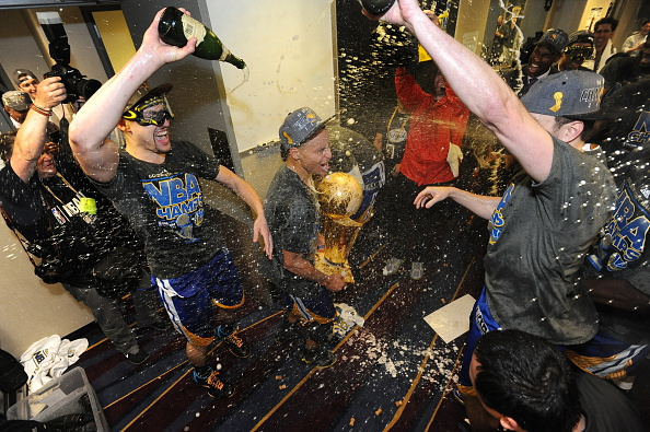 CLEVELAND, OH - JUNE 16: Klay Thompson #11 and Stephen Curry #30 of the Golden State Warriors celebrate winning the Larry O'Brein Trophy after Game Six of the 2015 NBA Finals against the Cleveland Cavaliers at the Quicken Loans Arena on June 16, 2015 in Cleveland, Ohio. NOTE TO USER: User expressly acknowledges and agrees that, by downloading and/or using this Photograph, user is consenting to the terms and conditions of the Getty Images License Agreement. Mandatory Copyright Notice: Copyright 2015 NBAE (Photo by Noah Graham/NBAE via Getty Images)