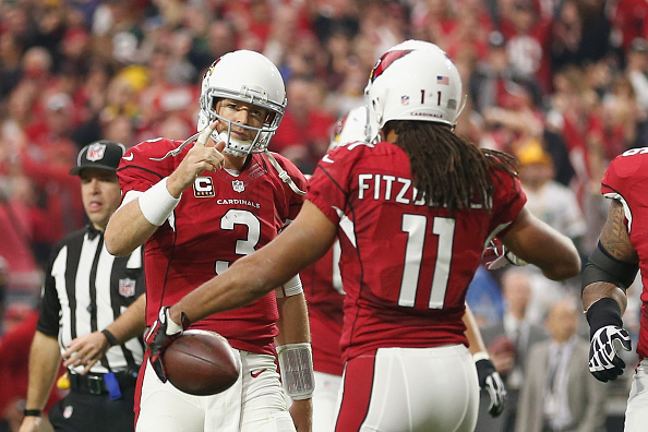GLENDALE, AZ - DECEMBER 27: Wide receiver Larry Fitzgerald #11 and quarterback Carson Palmer #3 of the Arizona Cardinals celebrate after Fitzgerald scored a 3 yard touchdown in the second quarter of the NFL game against the Green Bay Packers at the University of Phoenix Stadium on December 27, 2015 in Glendale, Arizona.  (Photo by Christian Petersen/Getty Images)