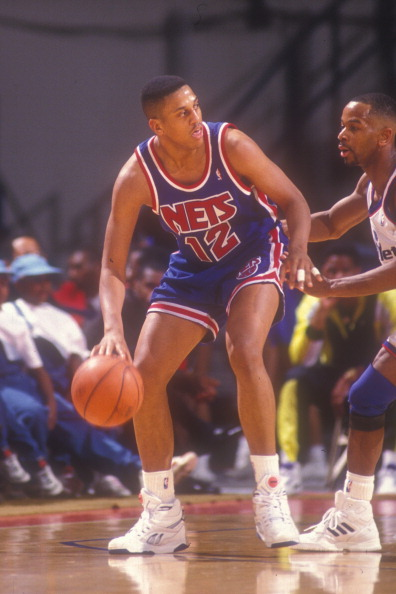 LANDOVER, MD - MARCH 25: Tate George #12 of the New Jersey Nets dribbles the ball during a basketball game against the Washington Bullets at the Capitol Centre on March 25 1991 in Landover , Maryland. The Bullets won 113-106. (Photo by Mitchell Layton/Getty Images)