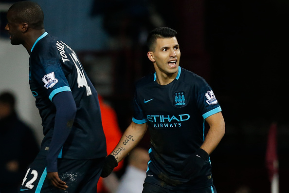 Manchester City's Argentinian striker Sergio Aguero (R) celebrates scoring an equalising goal for 1-1 during the English Premier League football match between West Ham United and Manchester City at The Boleyn Ground in Upton Park, in east London on January 23, 2016. AFP PHOTO / IKIMAGES  RESTRICTED TO EDITORIAL USE. No use with unauthorised audio, video, data, fixture lists, club/league logos or 'live' services. Online in-match use limited to 45 images, no video emulation. No use in betting, games or single club/league/player publications. / AFP / IKIMAGES / IKIMAGES        (Photo credit should read IKIMAGES/AFP/Getty Images)