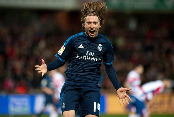 Real Madrid's Croatian midfielder Luka Modric celebrates a goal during the Spanish league football match Granada FC vs Real Madrid CF at Nuevo Los Carmenes stadium in Granada on February 7, 2016. AFP PHOTO / JORGE GUERRERO / AFP / Jorge Guerrero        (Photo credit should read JORGE GUERRERO/AFP/Getty Images)