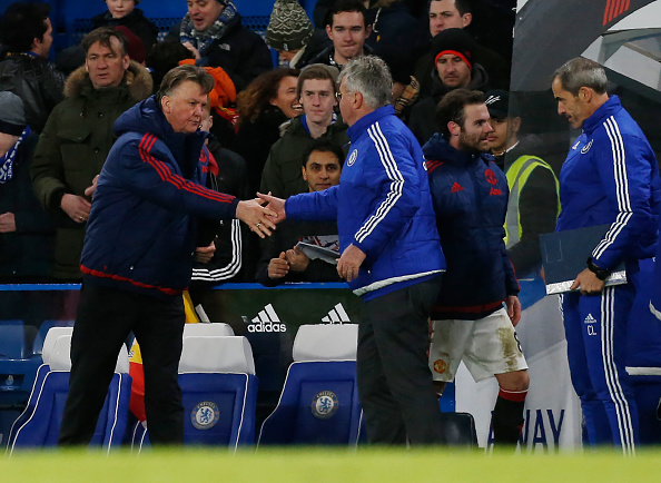 Manchester United's Dutch manager Louis van Gaal (L) shakes hands with Chelsea's Dutch interim manager Guus Hiddink after the English Premier League football match between Chelsea and Manchester United at Stamford Bridge in London on February 7, 2016. / AFP / Ian Kington / RESTRICTED TO EDITORIAL USE. No use with unauthorized audio, video, data, fixture lists, club/league logos or 'live' services. Online in-match use limited to 75 images, no video emulation. No use in betting, games or single club/league/player publications.  /         (Photo credit should read IAN KINGTON/AFP/Getty Images)