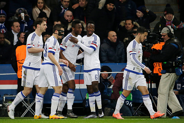 Chelsea's Nigerian midfielder John Obi Mikel (3rd L) celebrates with teammates after scoring a goal  during the Champions League round of 16 first leg football match between Paris Saint-Germain (PSG) and Chelsea FC on February 16, 2016, at the Parc des Princes stadium in Paris. AFP PHOTO / KENZO TRIBOUILLARD / AFP / KENZO TRIBOUILLARD        (Photo credit should read KENZO TRIBOUILLARD/AFP/Getty Images)