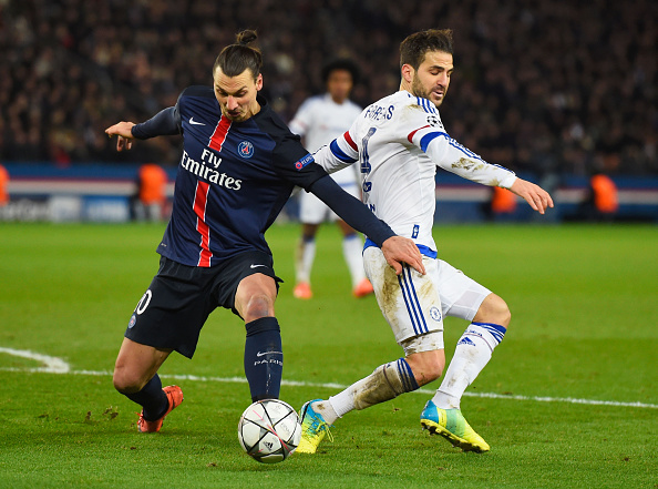 PARIS, FRANCE - FEBRUARY 16:  Cesc Fabregas of Chelsea battles with Zlatan Ibrahimovic of Paris Saint-Germain during the UEFA Champions League round of 16 first leg match between Paris Saint-Germain and Chelsea at Parc des Princes on February 16, 2016 in Paris, France.  (Photo by Mike Hewitt/Getty Images)