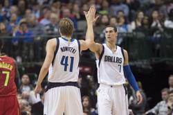 Dec 9, 2015; Dallas, TX, USA; Dallas Mavericks forward Dirk Nowitzki (41) and forward Dwight Powell (7) celebrate during the first half against the Atlanta Hawks at the American Airlines Center. Mandatory Credit: Jerome Miron-USA TODAY Sports