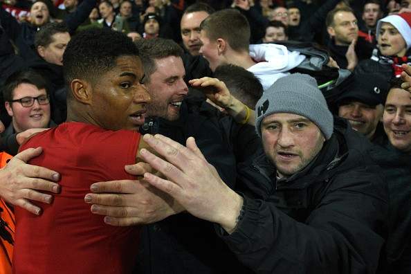 Manchester United's English striker Marcus Rashford (L) goes into the crowd as United players give away their shirts after the English Premier League football match between West Bromwich Albion and Manchester United at The Hawthorns stadium in West Bromwich, central England, on December 17, 2016.  Manchester United won the game 2-0. / AFP / Oli SCARFF / RESTRICTED TO EDITORIAL USE. No use with unauthorized audio, video, data, fixture lists, club/league logos or 'live' services. Online in-match use limited to 75 images, no video emulation. No use in betting, games or single club/league/player publications.  /         (Photo credit should read OLI SCARFF/AFP/Getty Images)
