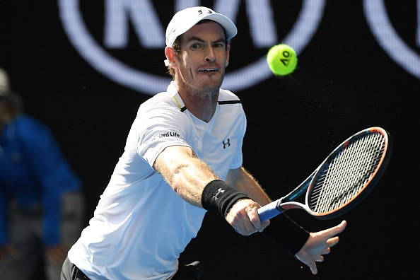 Britain's Andy Murray hits a return against Sam Querrey of the US during their men's singles third round match on day five of the Australian Open tennis tournament in Melbourne on January 20, 2017. / AFP / SAEED KHAN / IMAGE RESTRICTED TO EDITORIAL USE - STRICTLY NO COMMERCIAL USE        (Photo credit should read SAEED KHAN/AFP/Getty Images)