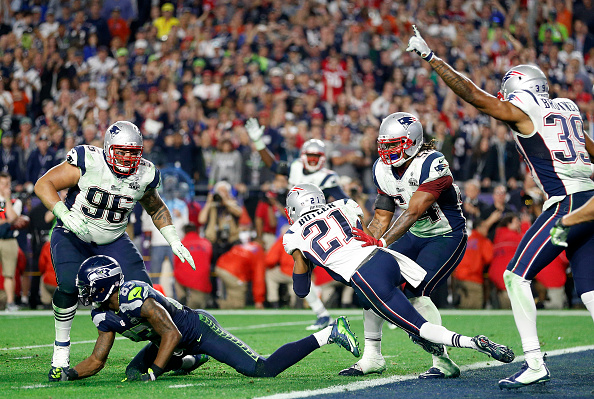 GLENDALE, AZ - FEBRUARY 01:  Malcolm Butler #21 of the New England Patriots intercepts a pass by Russell Wilson #3 of the Seattle Seahawks intended for Ricardo Lockette #83 late in the fourth quarter during Super Bowl XLIX at University of Phoenix Stadium on February 1, 2015 in Glendale, Arizona.  (Photo by Christian Petersen/Getty Images)