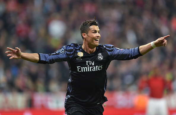 Real Madrid's Portuguese forward Cristiano Ronaldo celebrates after scoring during the UEFA Champions League 1st leg quarter-final football match FC Bayern Munich v Real Madrid in Munich, southen Germany on April 12, 2017.  Security was ratcheted up in Munich, one day after three explosions rocked the team bus of German football club Borussia Dortmund minutes after the bus set off to a planned Champions League game against Monaco on Tuesday night (April 11, 2017). / AFP PHOTO / Christof STACHE        (Photo credit should read CHRISTOF STACHE/AFP/Getty Images)