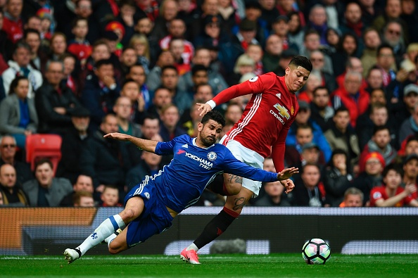 TOPSHOT - Chelsea's Brazilian-born Spanish striker Diego Costa (L) vies with Manchester United's Argentinian defender Marcos Rojo during the English Premier League football match between Manchester United and Chelsea at Old Trafford in Manchester, north west England, on April 16, 2017. / AFP PHOTO / Oli SCARFF / RESTRICTED TO EDITORIAL USE. No use with unauthorized audio, video, data, fixture lists, club/league logos or 'live' services. Online in-match use limited to 75 images, no video emulation. No use in betting, games or single club/league/player publications.  /         (Photo credit should read OLI SCARFF/AFP/Getty Images)