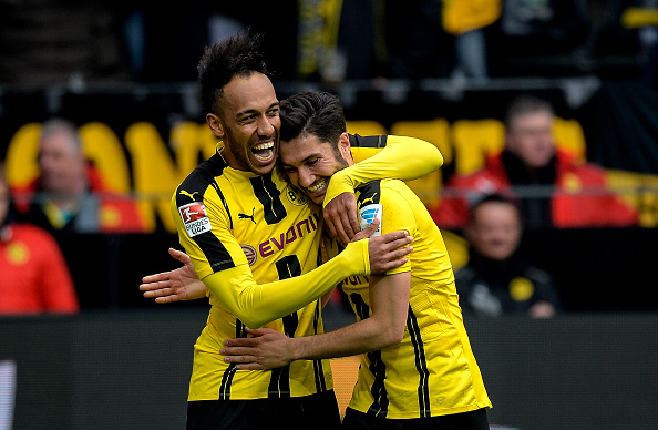 Dortmund's Gabonese forward Pierre-Emerick Aubameyang (L) celebrates his 3-1 goal during the German First division Bundesliga football match between Borussia Dortmund and Eintracht Frankfurt in Dortmund, western Germany, on April 15, 2017. / AFP PHOTO / SASCHA SCHUERMANN / RESTRICTIONS: DURING MATCH TIME: DFL RULES TO LIMIT THE ONLINE USAGE TO 15 PICTURES PER MATCH AND FORBID IMAGE SEQUENCES TO SIMULATE VIDEO. == RESTRICTED TO EDITORIAL USE == FOR FURTHER QUERIES PLEASE CONTACT DFL DIRECTLY AT + 49 69 650050         (Photo credit should read SASCHA SCHUERMANN/AFP/Getty Images)