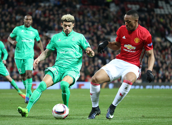 MANCHESTER, ENGLAND - FEBRUARY 16: Kevin Malcuit of Saint-Etienne and Anthony Martial of Manchester United in action during the UEFA Europa League Round of 32 first leg match between Manchester United and AS Saint-Etienne (ASSE) at Old Trafford stadium on February 16, 2017 in Manchester, United Kingdom. (Photo by Jean Catuffe/Getty Images)