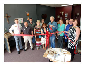 Chamber photo group ribbon cutting