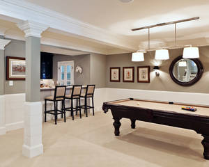 Transitional basement remodeling pictures with grey also white wall paint color also classic bar design with classic black wooden bar stool with beige fabrics color and be