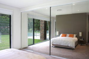 Remarkable wide size of the closet doors with mirrors which has the frameless style with the clear mirror appearance