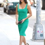 Olivia Munn stuns in a low cut, green dress as she is spotted out and about in New York City