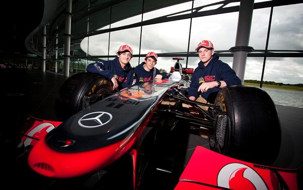 Caterham School team with McLaren MP4-27 (left to right - Ben Dillon, Ivan May-Jones & Alex Jobson)