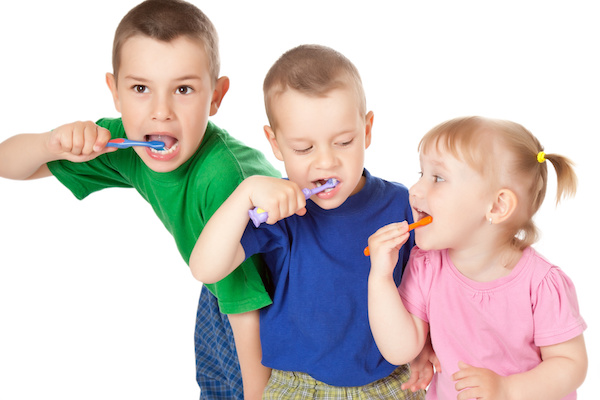 studio shot of children to brush his teeth