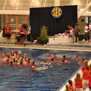 "SEC Champion Women's Swim and Dive Squad ""Call the Dawgs"" in from the diving well."