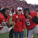 Jarvis Jones and Jon Jenkins pose with honorary water boy Cody Roberts after Saturday's win. Georgia 19, Kentucky 10. November 19, 2011; Sanford Stadium, Athens, GA. (Photo: Scates/BI)