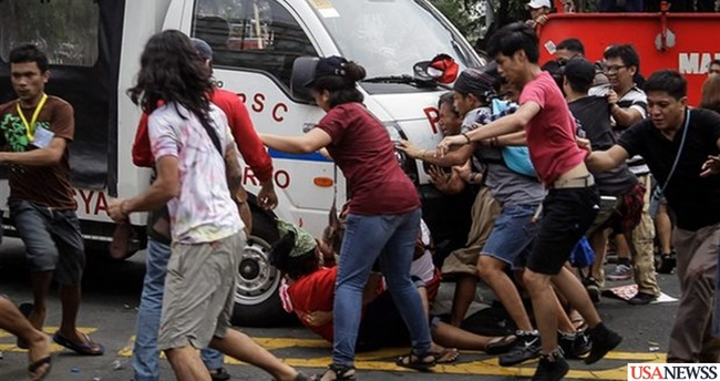 Police van in Philippines crashes into protesters in Manila outside embassy of US