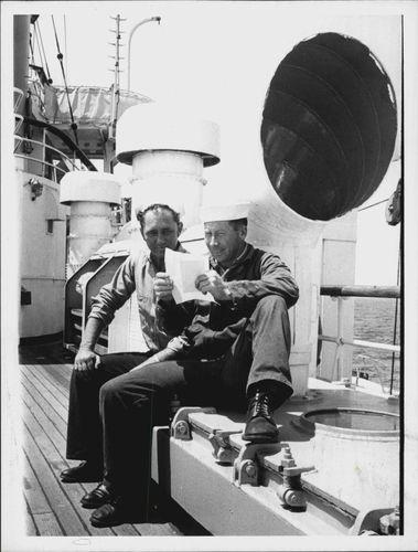 Photo of Explorer Ship Crew Members Reading Letters from Home, 1967