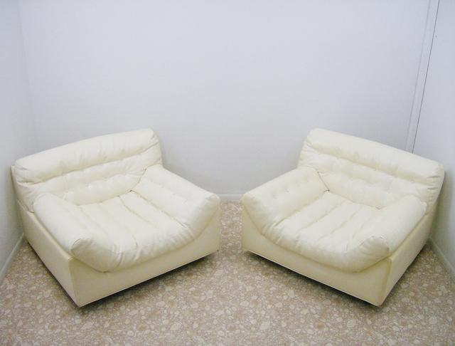 Pair of White Vinyl Lounge Chairs