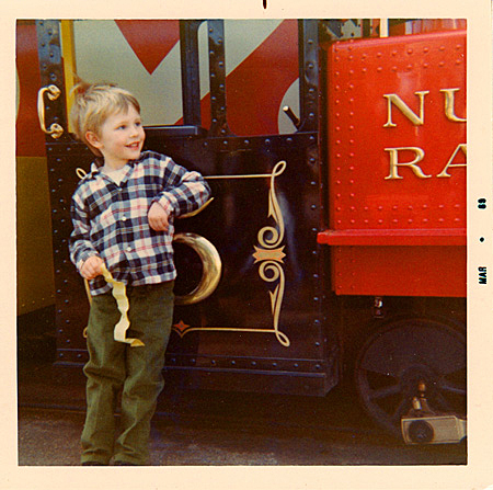 Sean (4) admiring letterforms on Nut Tree train