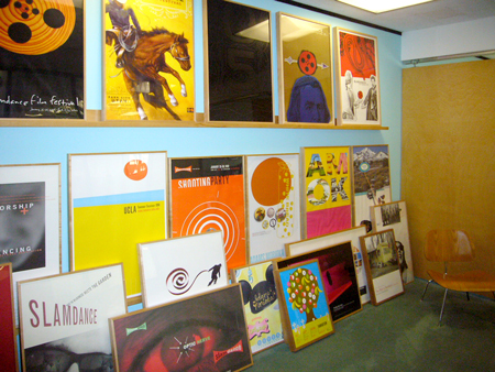lobby wall of posters, we running out of space, so we hide the ugly ones