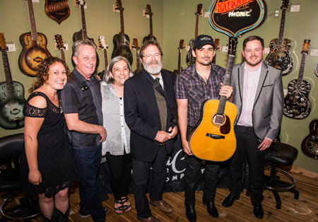 (L-R): Carolyn Sills,  Head of Operations – SCGC; Bill Warmoth, Owner Artisan Guitars; Ellie Warmoth, Owner Artisan Guitars;  Richard Hoover, CEO/Founder SCGC; Paisley, Ryan Jacobson, Production Manager SCGC  Photo By: Ben Enos