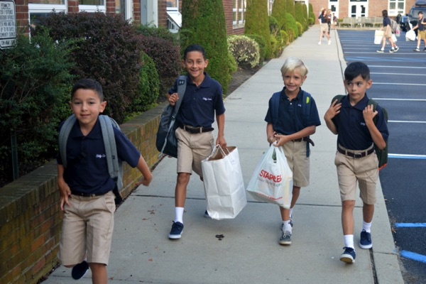 Holy Cross Students Return To School