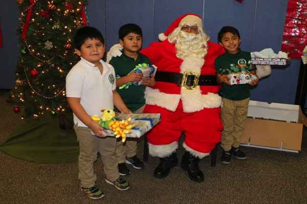 Santa Visits 200 Children at Bucky James Community Center