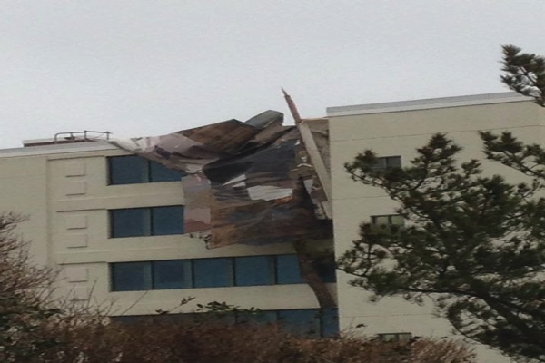 Storm Rips Off Roof Of Long Branch Building