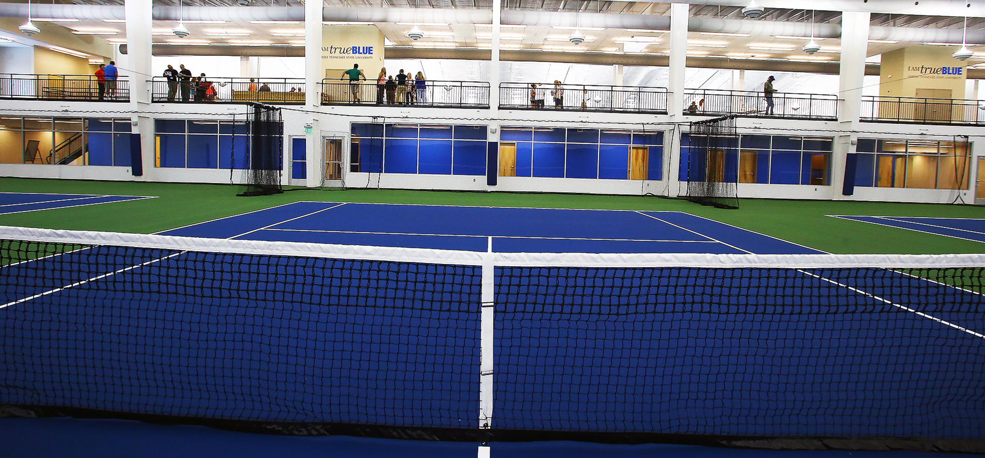 Open house for the new indoor tennis facility in Old Fort Park was packed