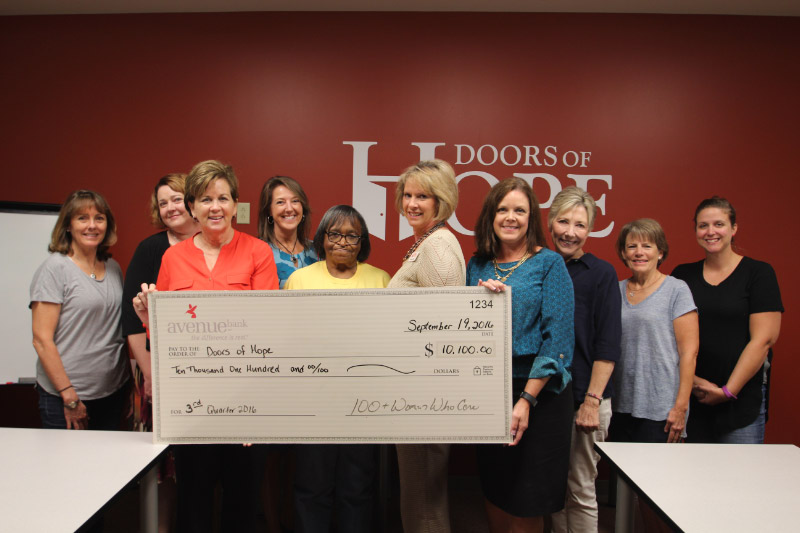 Doors of Hope Receives Check for $10,100 from 100+ Women Who Care of Middle Tennessee