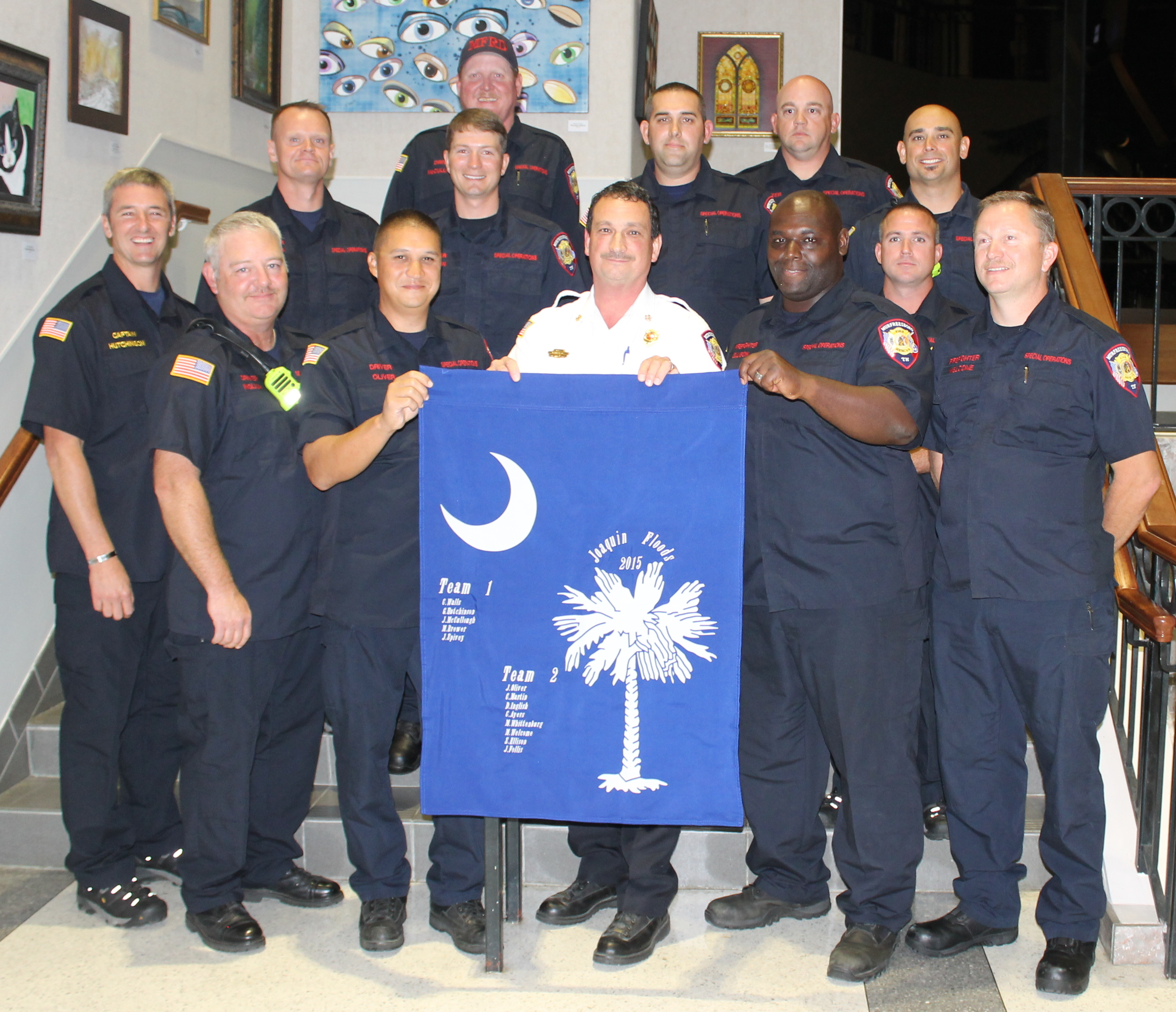 South Carolina Teams Present Memorabilia to Fire Rescue Chief Foulks at City Council Meeting