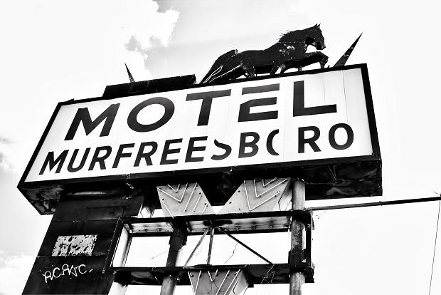Armed man in victims motel bathroom