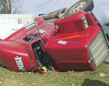 Tractor Trailer Truck flips over on East Jefferson Pike Monday