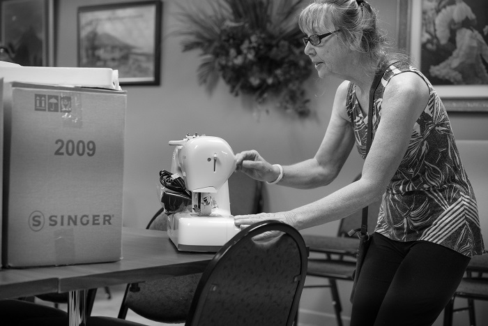 20 New Singer Sewing Machines Donated to Greenhouse Ministries for Sewing Class