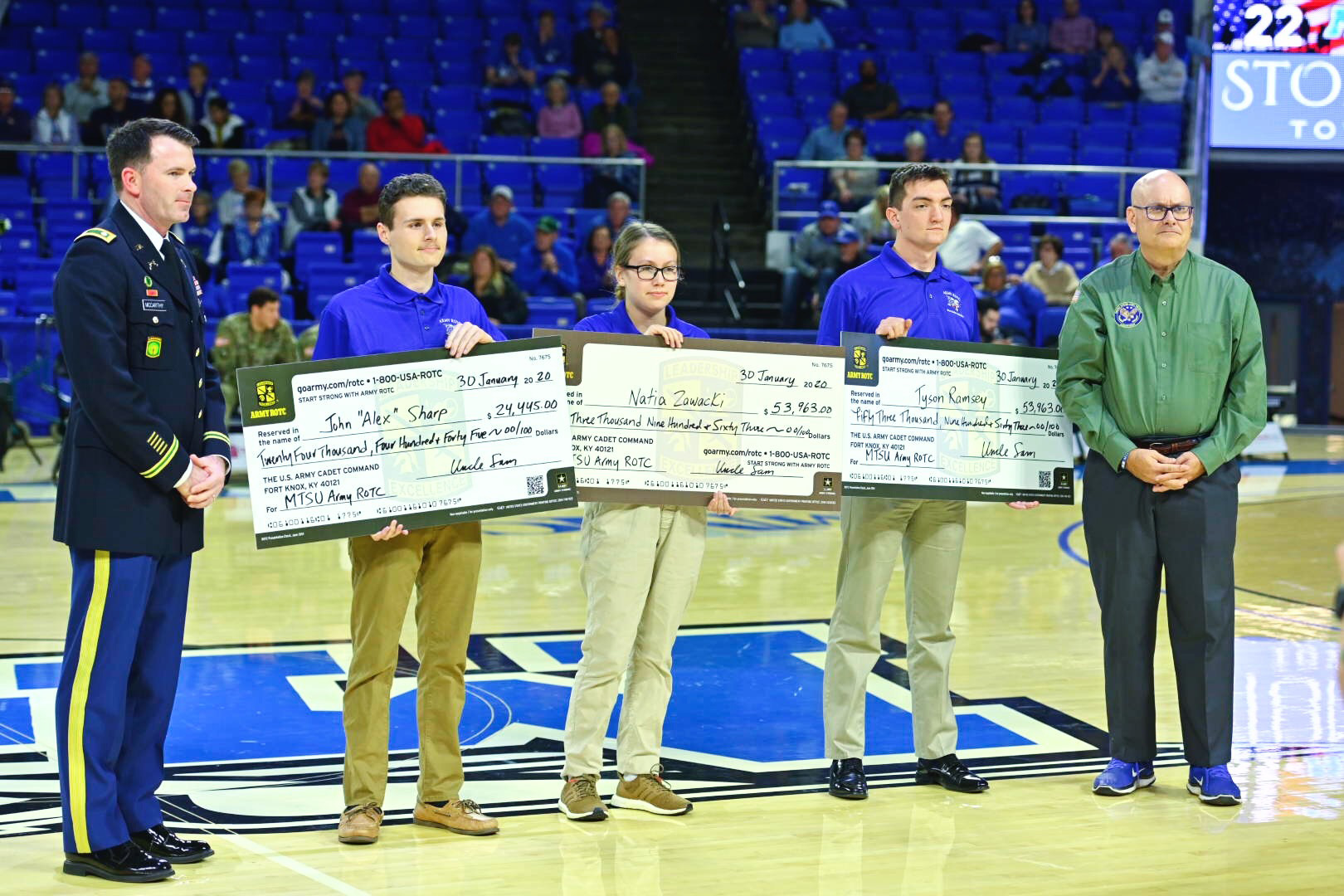 Three Middle Tennessee State University ROTC cadets were awarded Army Reserve scholarships during veteran appreciation events at a recent Women's Basketball game at Murphy Center.