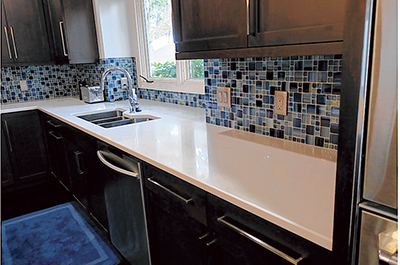 Quartz countertops are increasingly popular for their durability, low maintenance and wide color selection. PHOTO COURTESY DISTINCTIVE GRANITE AND MARBLE