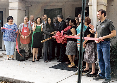 The cutting of the ribbon at the Education and Resource Center brought cheers and applause. LYNNE COPE HUMMELL