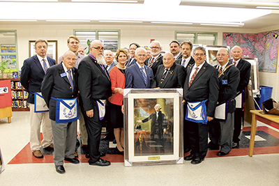 Beaufort Middle School principal Carole Ingram, in red, poses with members of countywide Mason Lodges following their presentation of framed portraits of George Washington for all the Beaufort County School District schools. COURTESY BCSD