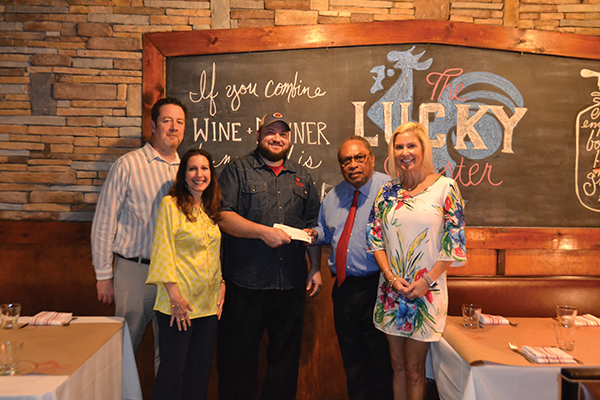 Present for the Chef Showdown check presentation April 26 were, from left, Chef Lee Lucier of FISH; Nancy Sulek, development office for VIM; Chef Clayton Rollison of Lucky Rooster; Dr. Ray Cox, executive director of VIM); and Ginger Allen, development dir