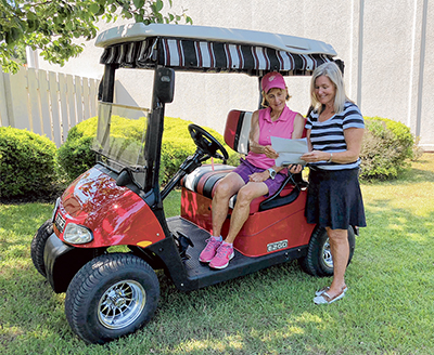 Dr. Jean Harris, in her new cart, with Margie Donley.