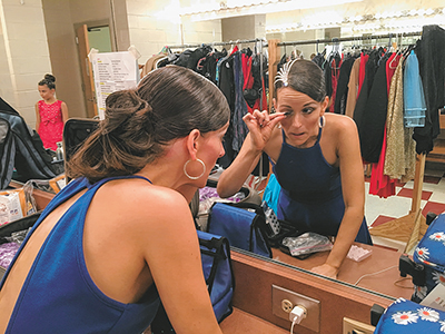 Backstage peek into preparing for ballroom dance event